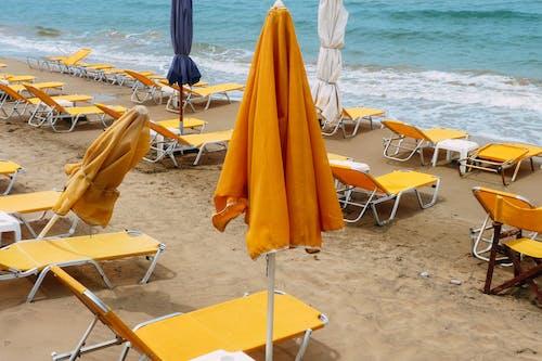 Beach with colorful deckchairs on beach