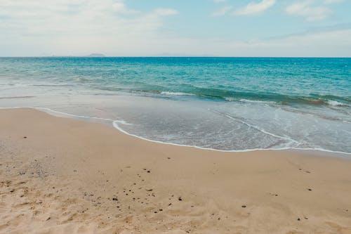 Sandy beach with rippling sea