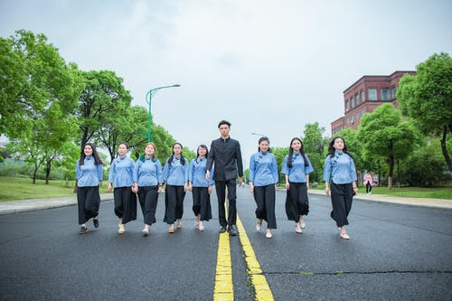 Group of People Standing on Road