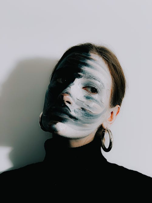 Creative female model with painted face