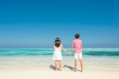 2 Girls Standing on Beach