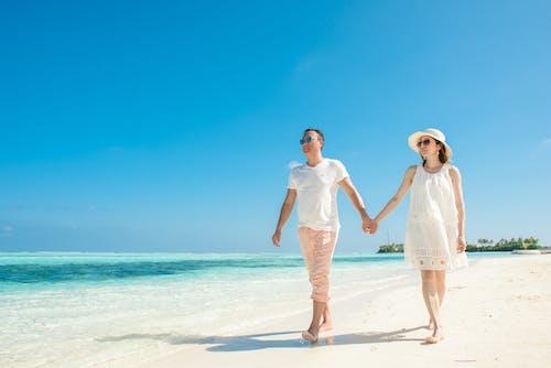 2 Women in White Dress Standing on Beach
