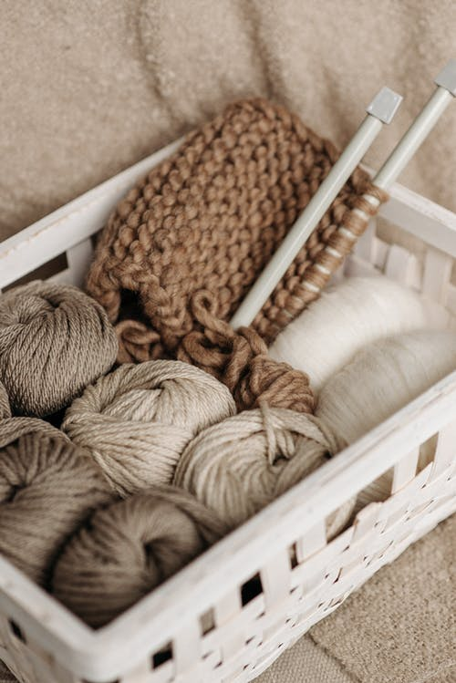 White and Brown Yarns In Basket