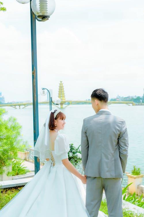 Man in Gray Suit Jacket Beside a Woman in Wedding Dress