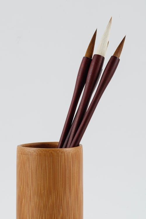 Set of calligraphy brushes in bamboo glass