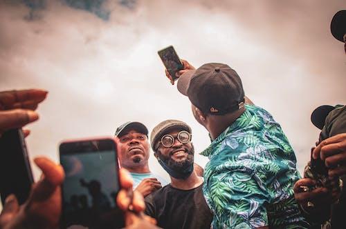 Man in Black Crew Neck Shirt Holding Black Smartphone