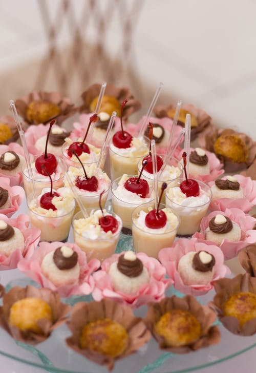 White and Pink Cupcakes on White Tray