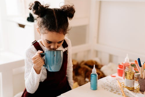 A Kid Drinking Hot Drink