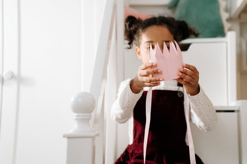 Girl Holding a Paper Crown