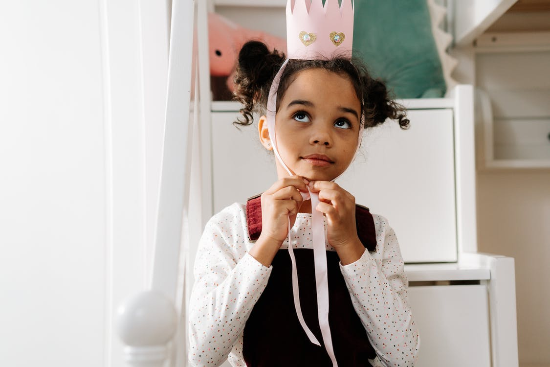 Girl Putting Her Crown