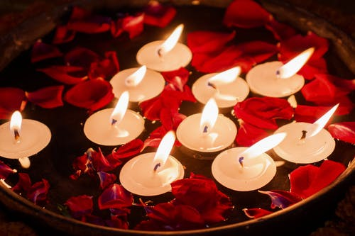 Red Petals and Candles Floating