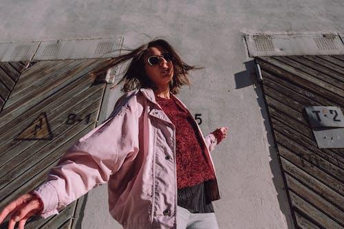 Stylish calm woman spinning on street