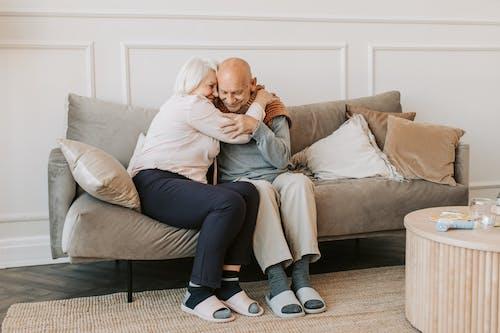 Woman Hugging Man in Gray Long Sleeve Shirt