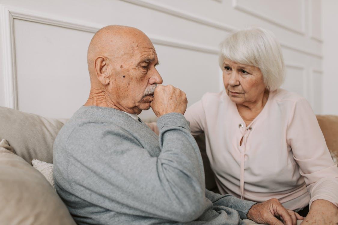 Woman Looking at Man in Gray Shirt