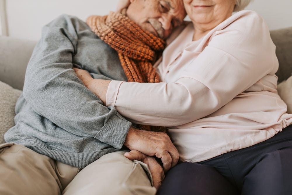 Two elderly people resting in bed.   Photo: Pexels
