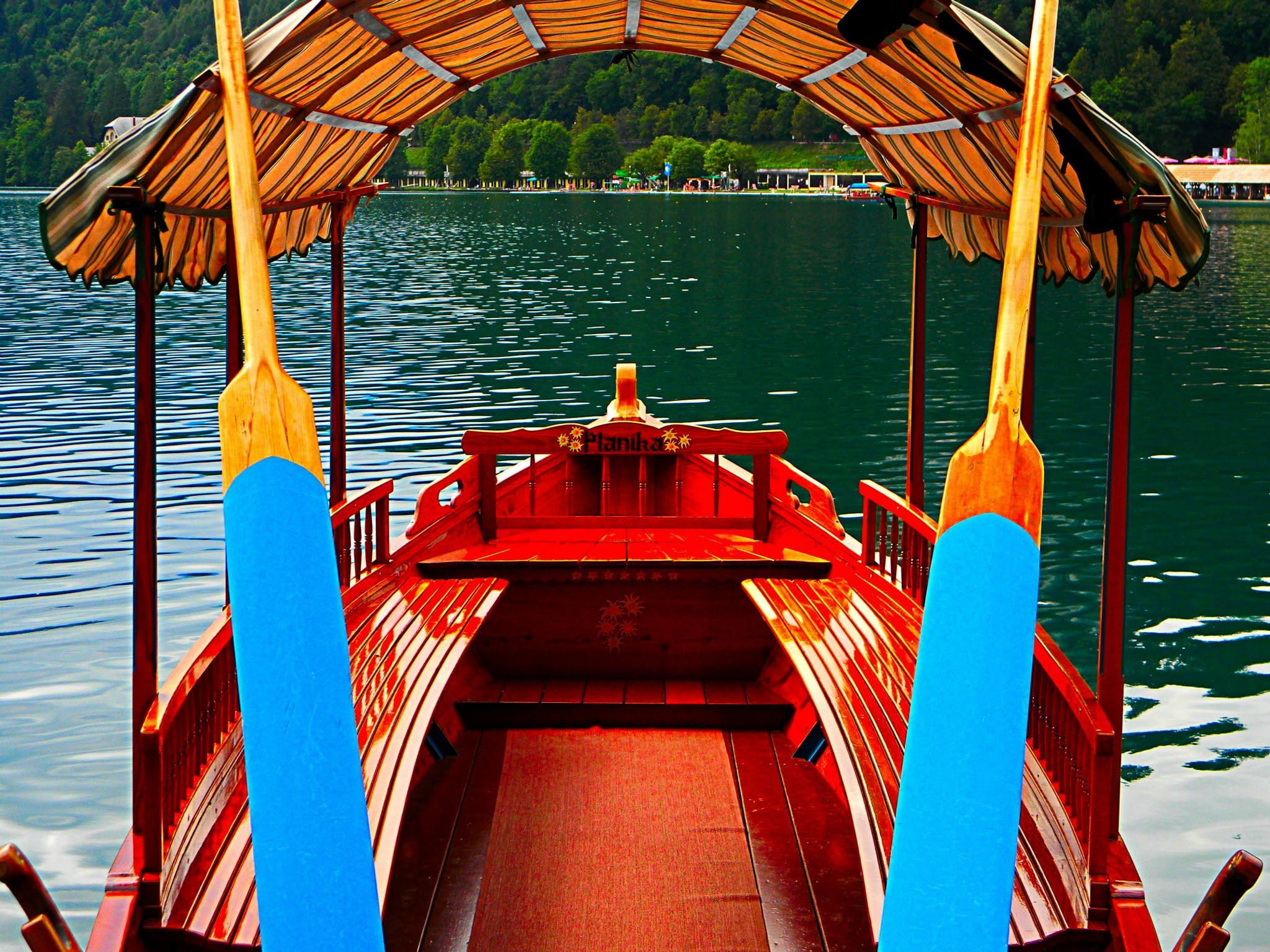 Red Boat on Body of Water