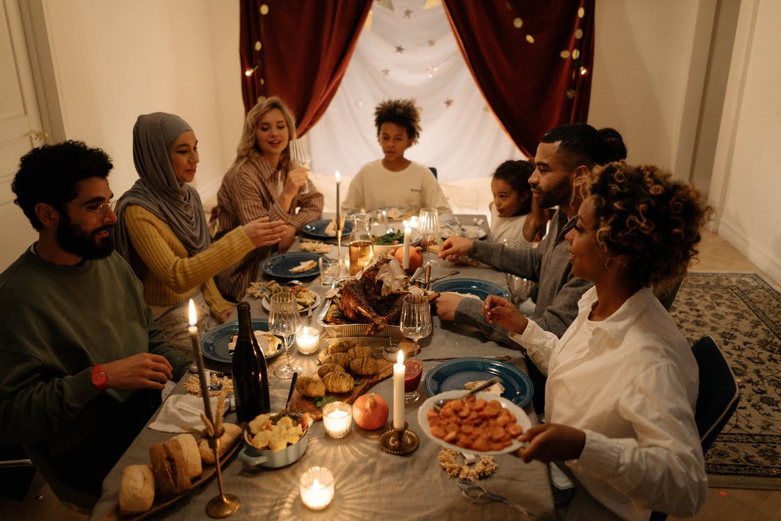 People Sitting Around Table With Food