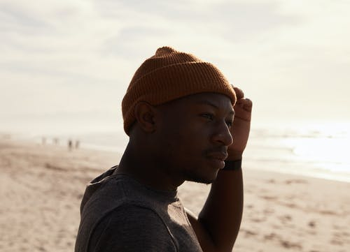 Black man on sandy beach