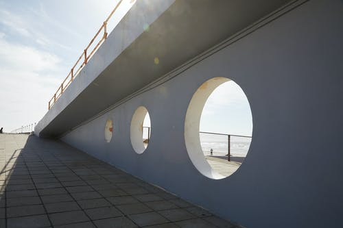 Holes in wall of bridge in daytime