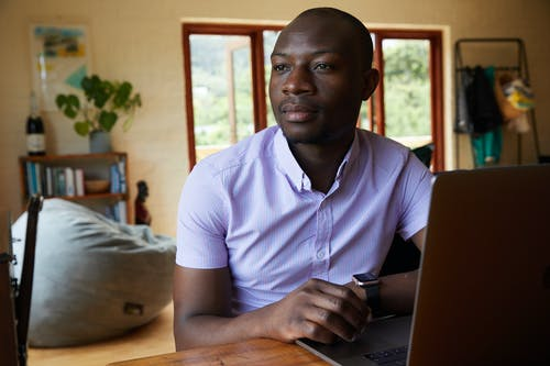 Black entrepreneur with smart watch and laptop