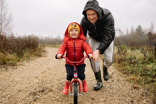 A Father Teaching His Child How to Ride a Bike