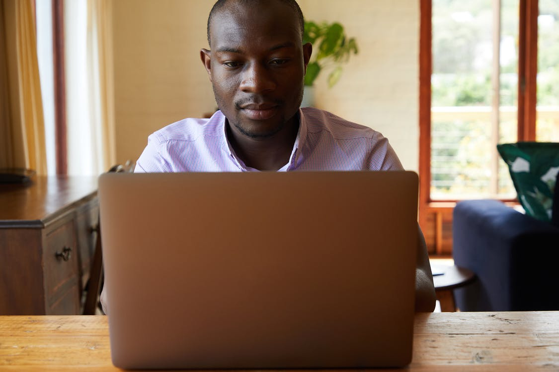 Serious African American man with laptop