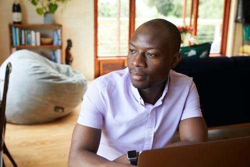 Thoughtful African American man working at home