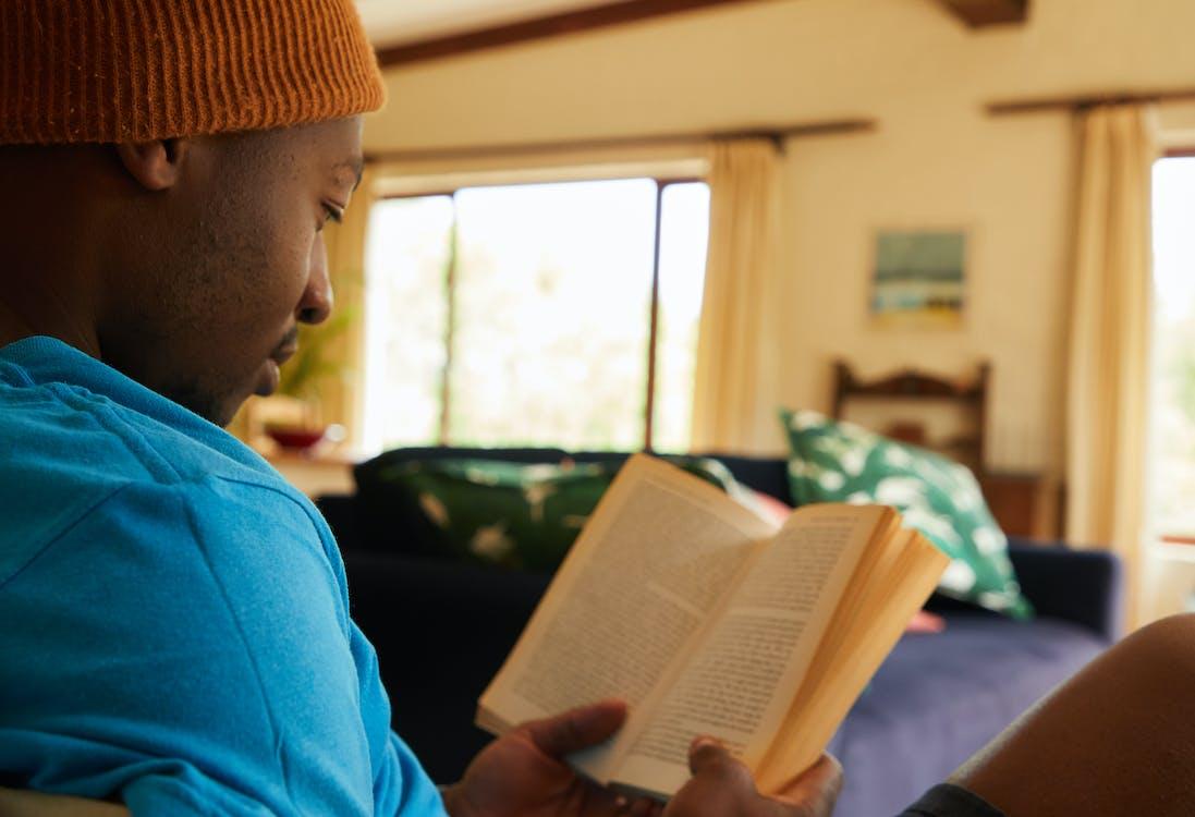 Crop black man studying at home