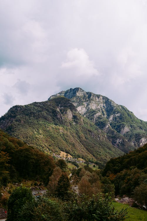 Mountain ridge with green plants in valley
