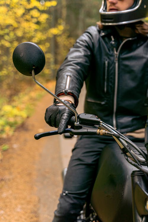 Man in Black Leather Jacket Riding on Motorcycle