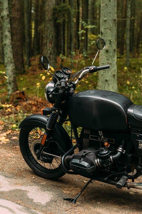 Black Motorcycle Parked on Brown Dirt Road