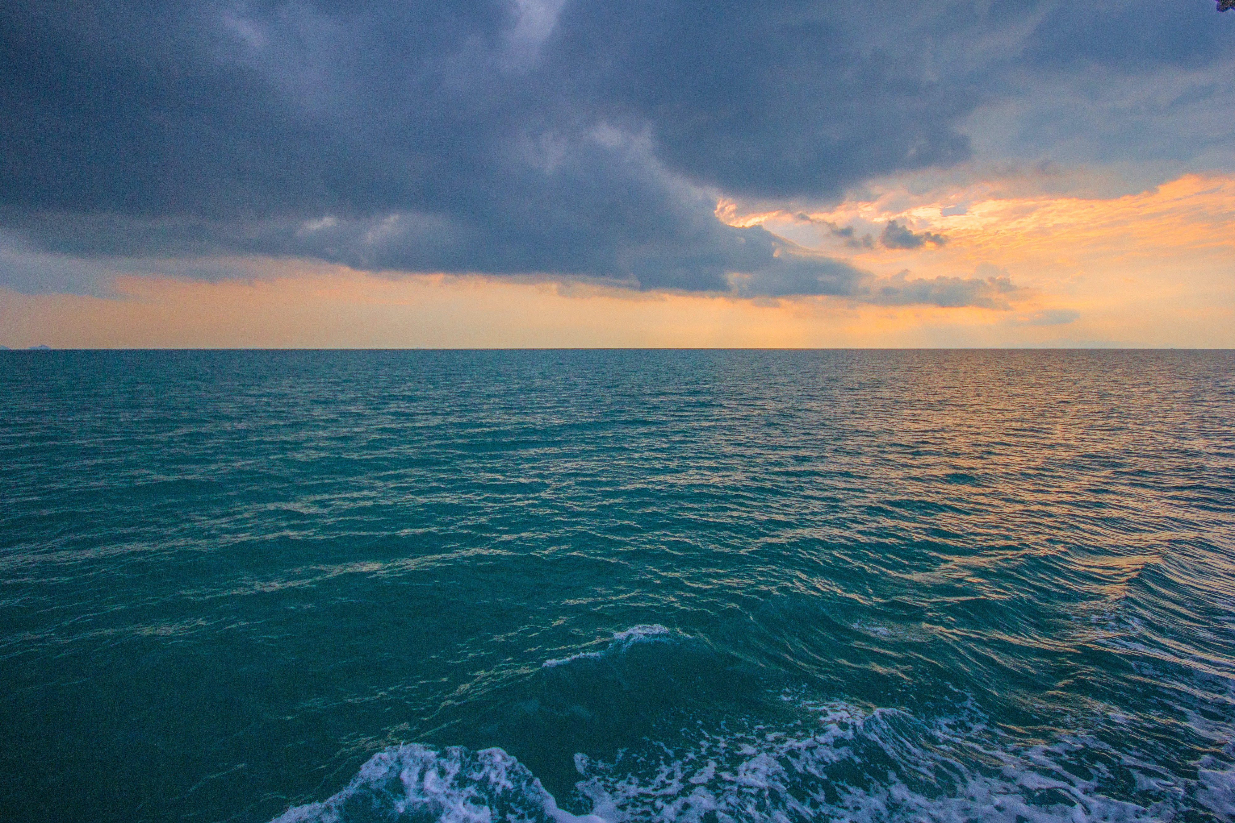 Blue Body of Water Under White Clouds · Free Stock Photo