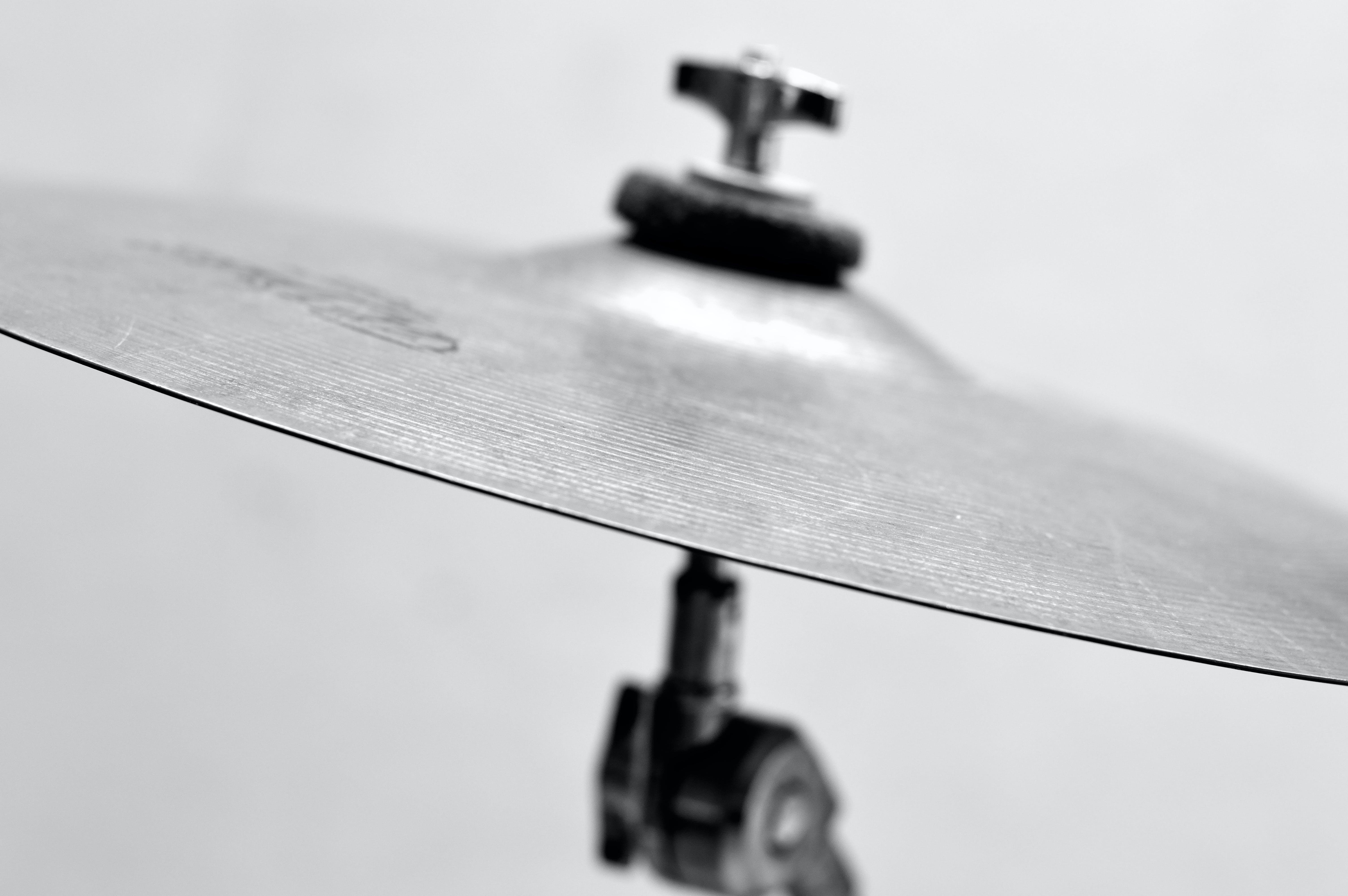 Selective Focus Photo of Gray Cymbal