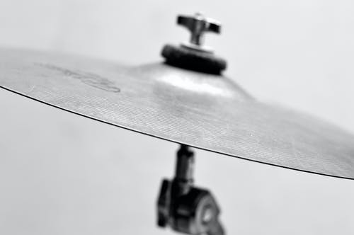 Selective Focus Photo of Gray Cymbal