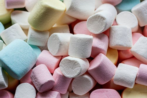 White Pink Yellow and Blue Heart Shaped Candies