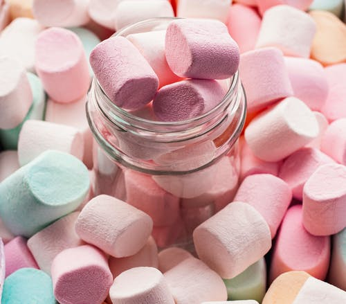 Pink and White Heart Shaped Candies in Clear Glass Jar