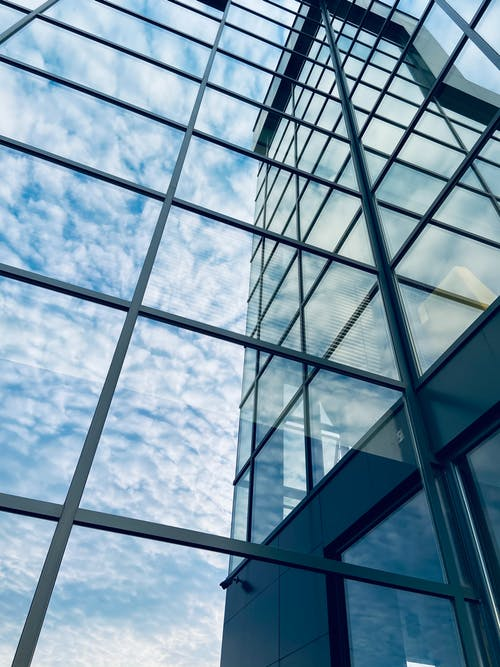 Free stock photo of architectural building, glass windows, reflection