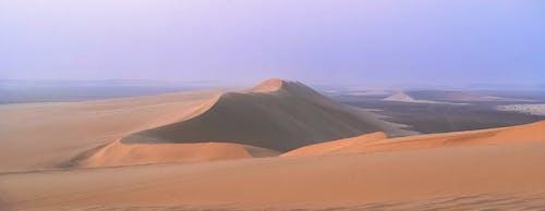 Great sand dunes in desert at sundown