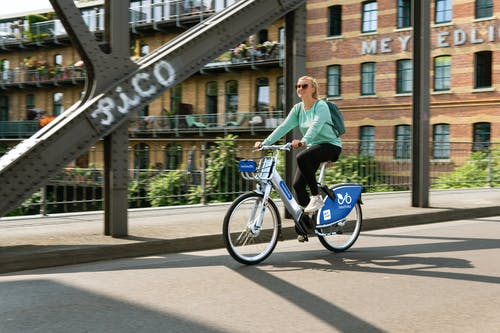 A Woman Riding a Bike in the City