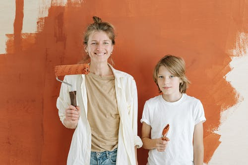 Mother and Son Painting their Apartment