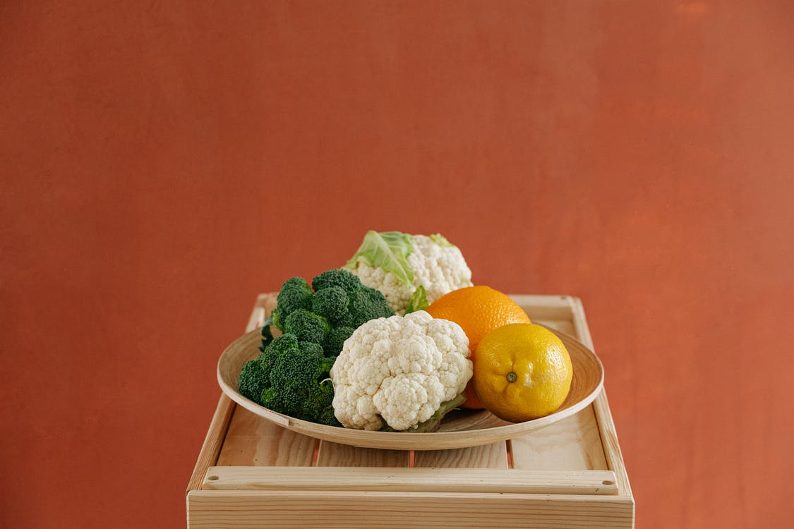 Orange Fruit on White Ceramic Plate