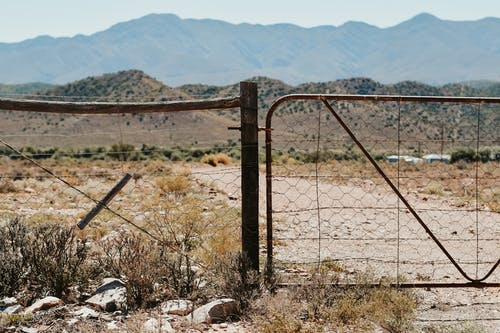 Fenced barrier in dry remote terrain