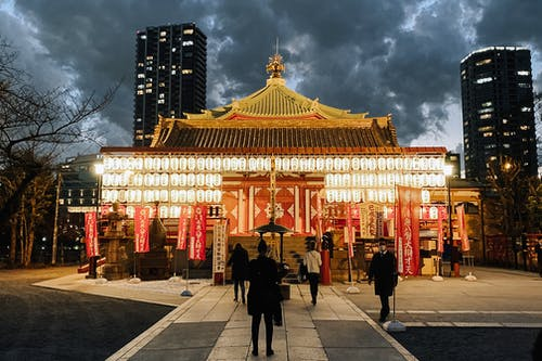 Oriental shrine in city park at night