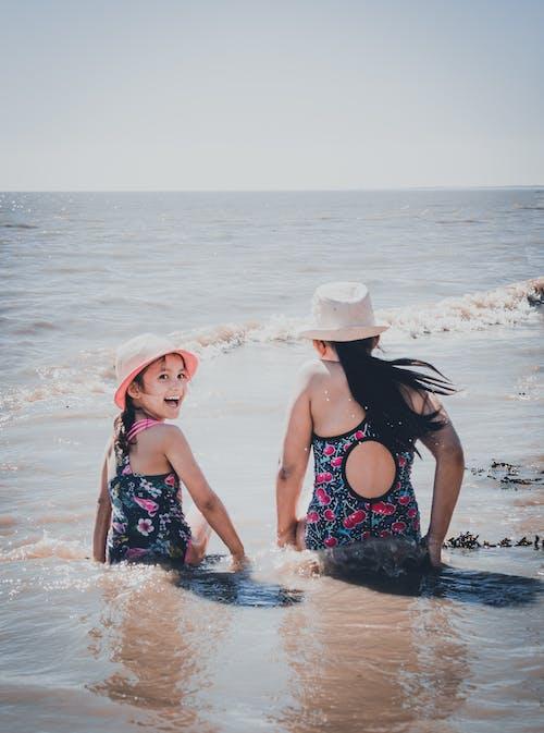 Kids Swimming on the Beach