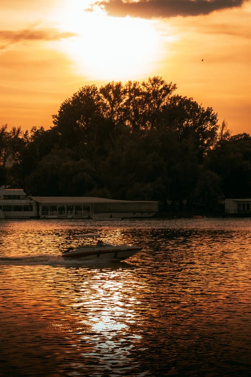 Speedboat on the Lake during Sunset
