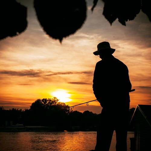 A Silhouette of Person Fishing