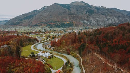 Rural town in mountainous terrain with river