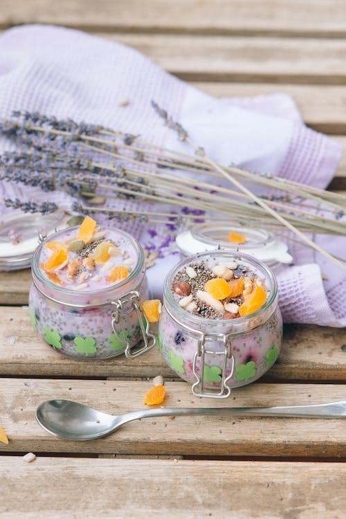 Stainless Steel Spoon Beside Clear Glass Jar