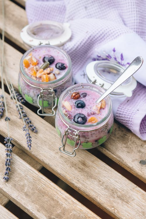 Stainless Steel Spoon on Clear Glass Jar