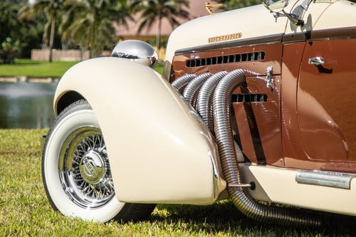 White and Brown Vintage Car